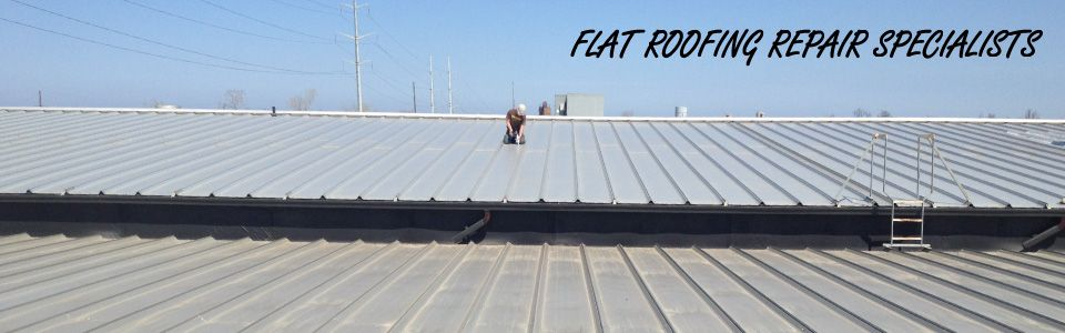 Flat Roofing Repair Specialists | man working on flat roof